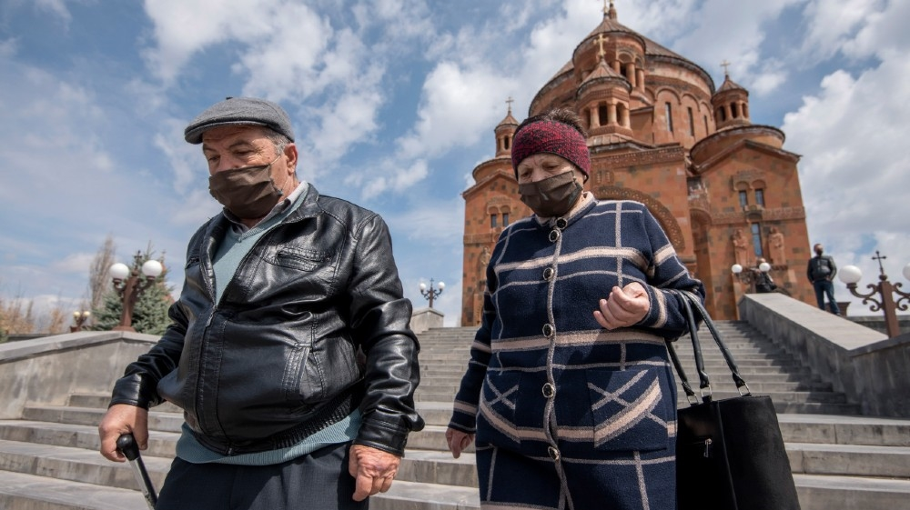 Armenian Apostolic Church believers wearing protective masks leave the Cathedral in Abovyan, some 30km from Yerevan on Easter Sunday on April 12, 2020, amid the COVID-19 o