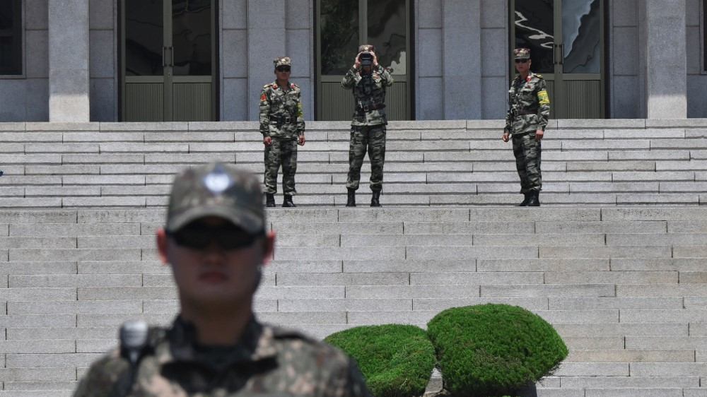 North and South Korea 'exchange gunfire across border' thumbnail