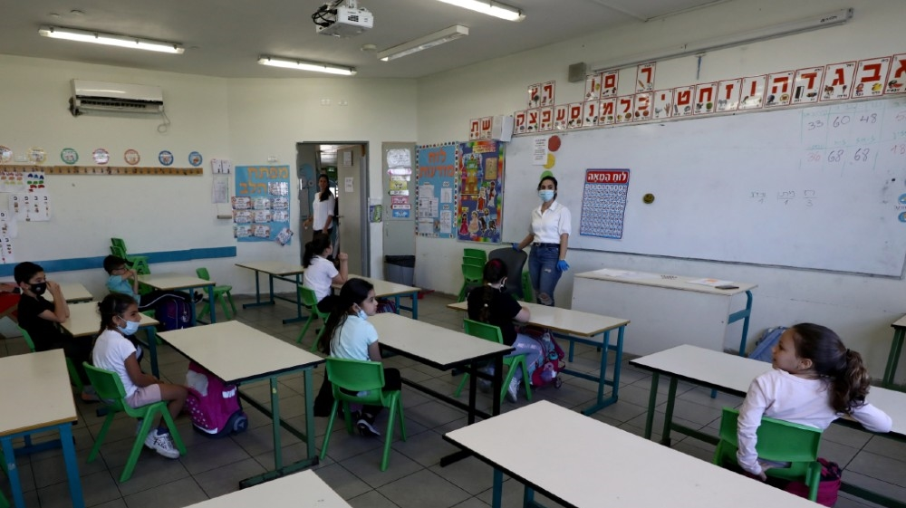 Students sit in classroom at their elementary school as it reopens following the ease of restrictions preventing the spread of the coronavirus disease (COVID-19),