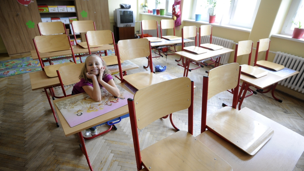 A primary school student Mia smiles inside a classroom in an empty school, closed during a one-day strike by local teachers, in Bratislava