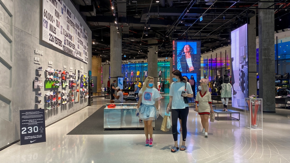 People wearing protective face masks and gloves shop at Dubai mall after the UAE government eased a curfew and allowed stores to open, following the outbreak of the coronavirus disease in Dubai