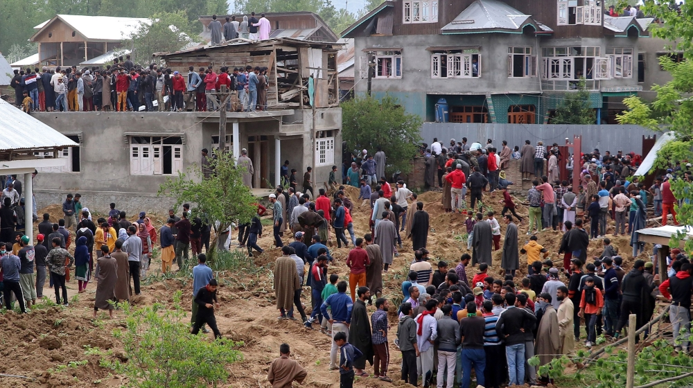 People gather after two militants including Hizbul Mujahideen commander Riyaz Naikoo were killed in a gun battle with Indian soldiers at Beighpora village in south Kashmir's Pulwama district May 6, 20