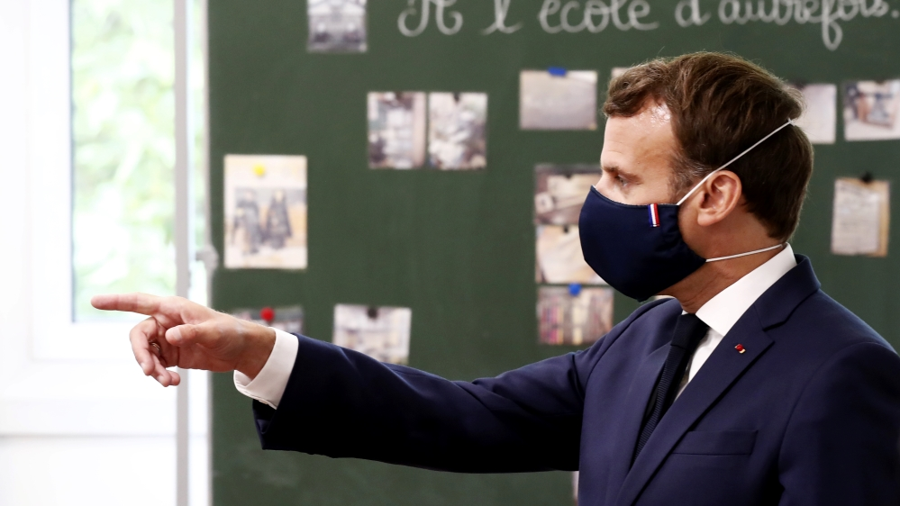 French President Macron visits a school in Poissy