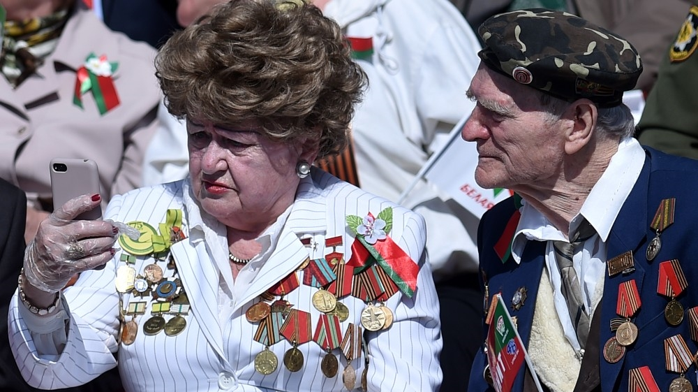 Veterans gather to watch a military parade to mark the 75th anniversary of the Soviet Union's victory over Nazi Germany in World War Two, in Minsk on May 9, 2020. Sergei GAPON / AFP