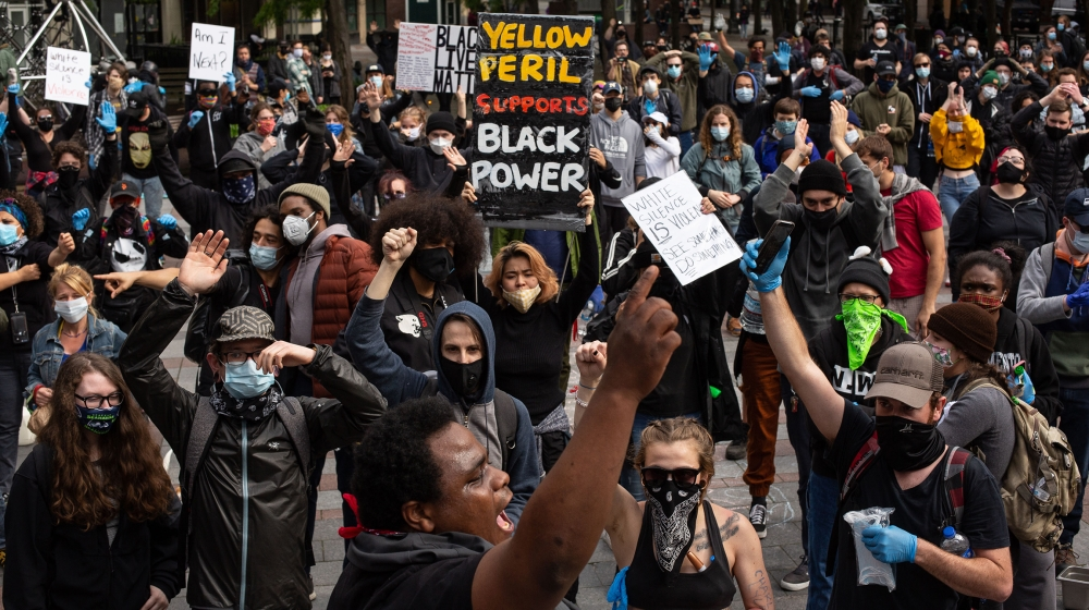 Demonstrators chant during a gathering to protest the recent death of George Floyd on May 31, 2020 in Seattle, Washington. Protests due to the recent death of George Floyd took place in Seattle and it