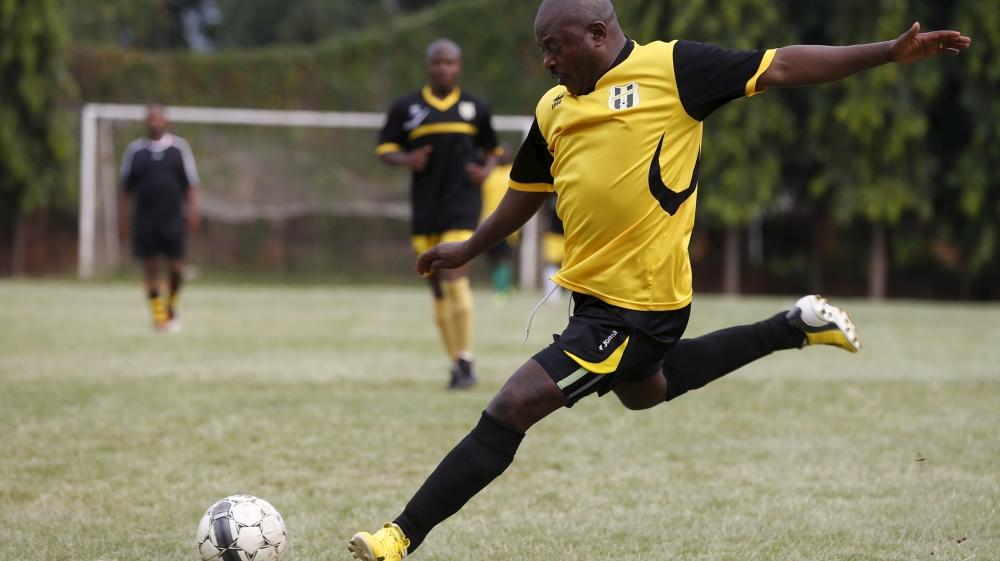 Nkurunziza kicks the ball during a soccer game with his friends in Bujumbura