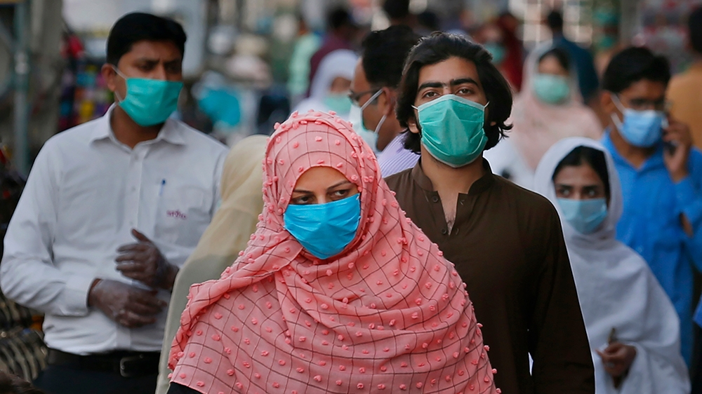 People wearing masks to help curb the spread of the coronavirus shop in a market in Rawalpindi, Pakistan, Tuesday, June 2, 2020. (AP Photo/Anjum Naveed)
