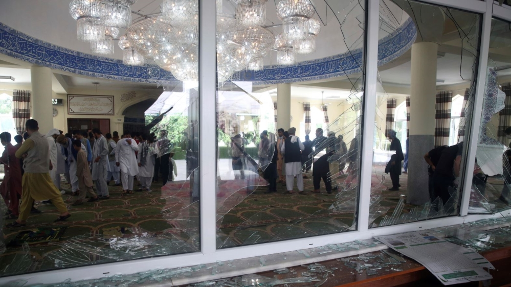 Afghans inspect the inside of a mosque following a bombing, in Kabul, Afghanistan, Friday, June 12, 2020.