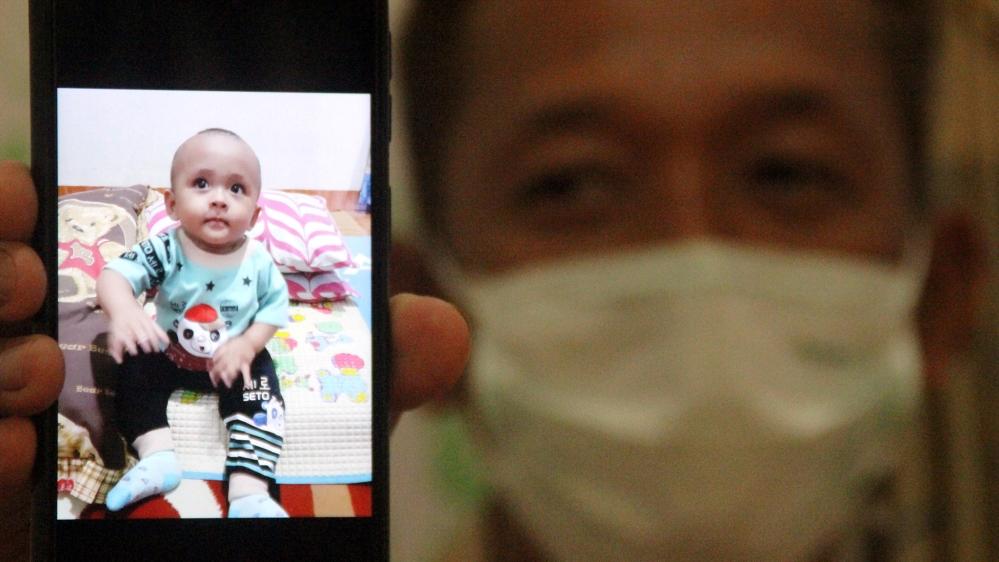 Indonesia's suspected child coronavirus deaths highlight danger thumbnail