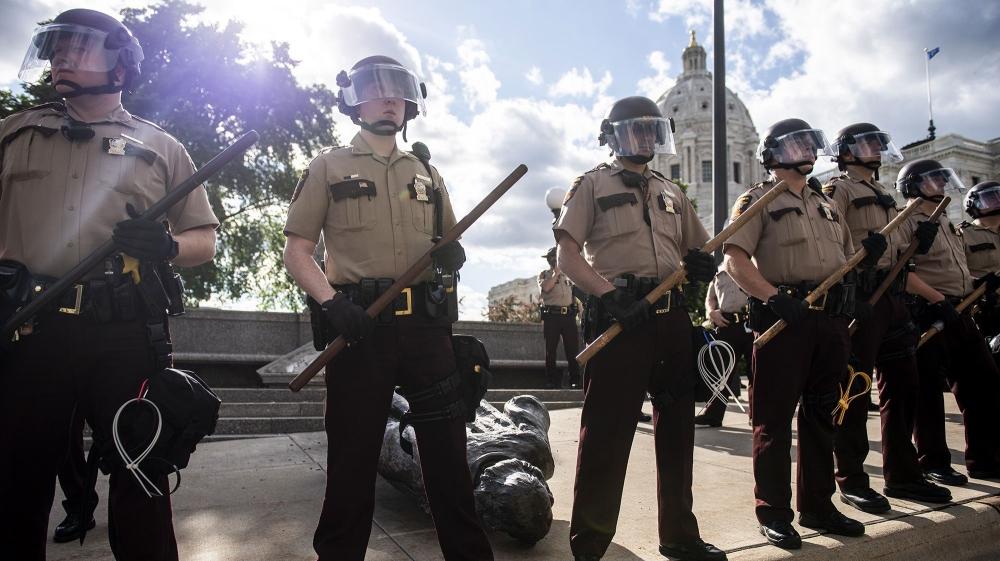 Members of the Minnesota State Patrol stand guar