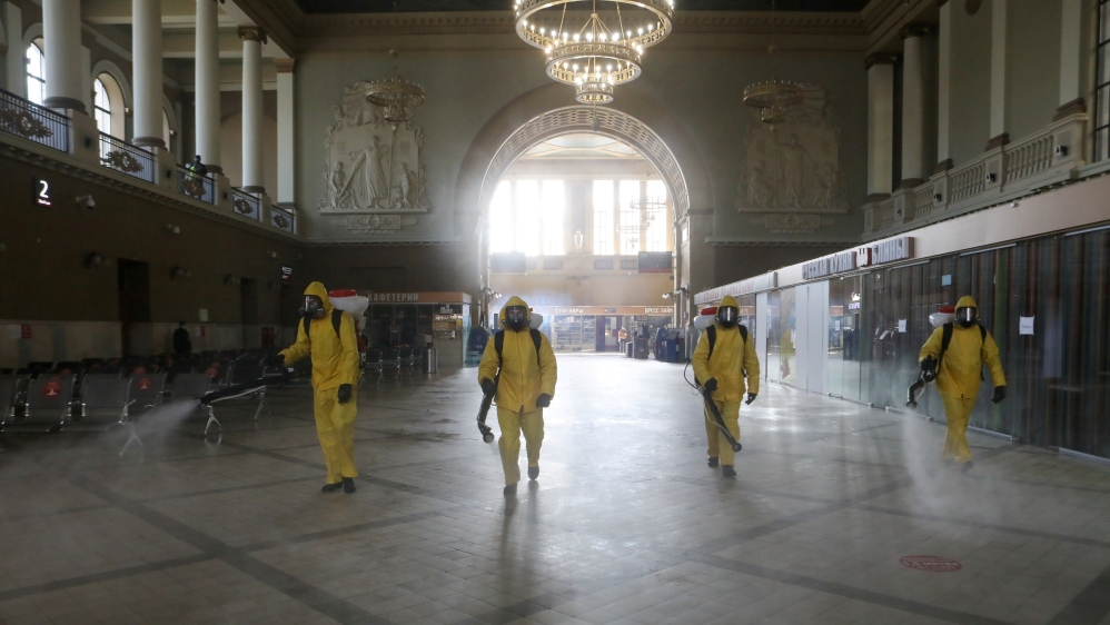 Emergencies Ministry members sanitize a railway station amid the outbreak of the coronavirus disease in Moscow