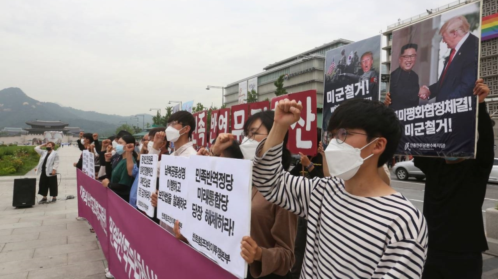 North Korea threatens reprisals as South tries to uphold peace