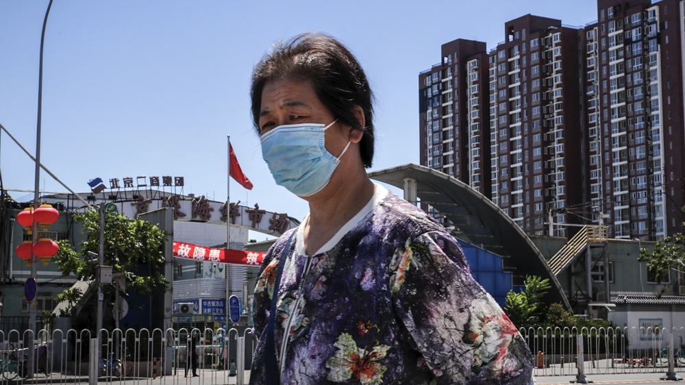 'Decisive measures' in Beijing as coronavirus cases spike: Live - Al Jazeera English