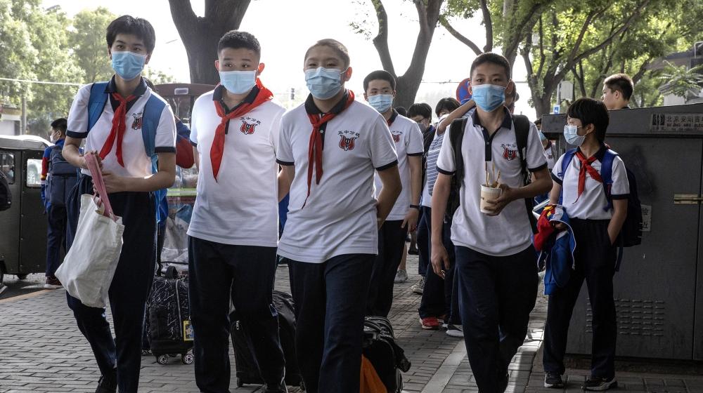 Beijing shuts schools over new coronavirus outbreak: Live updates ...
