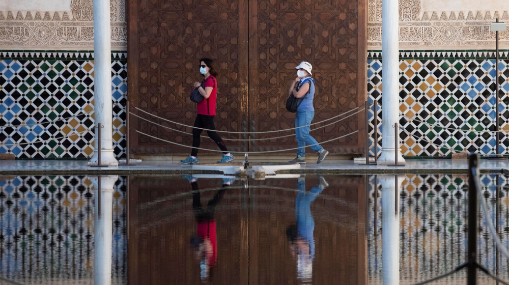 epa08490308 The first visitors walk at Alhambra Palace  that has reopened in Granada, Spain, 17 June 2020, with a 50 percent of its capacity and 4,250 tickets per day. The visit has some itinerary mod