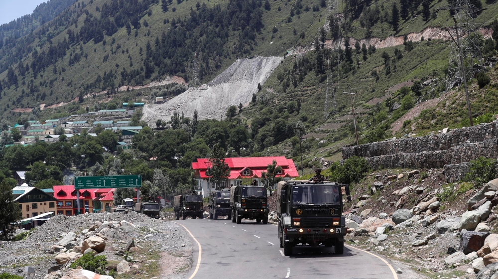Indian army trucks move along a highway leading to Ladakh, at Gagangeer in Kashmir's Ganderbal district June 17, 2020. REUTERS/Danish Ismail