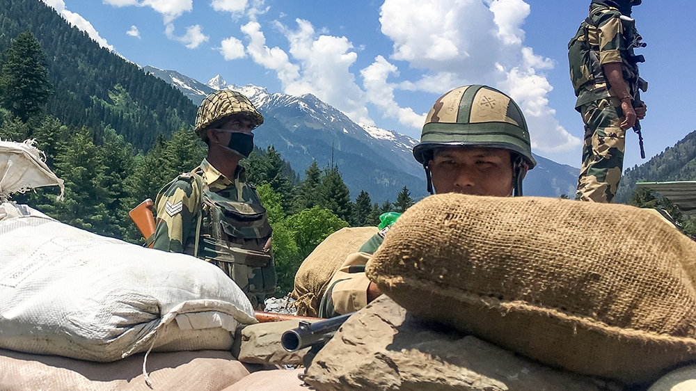 Indian Border Security Force (BSF) soldiers guard a highway leading towards Leh, bordering China, in Gagangir on June 17, 2020. -