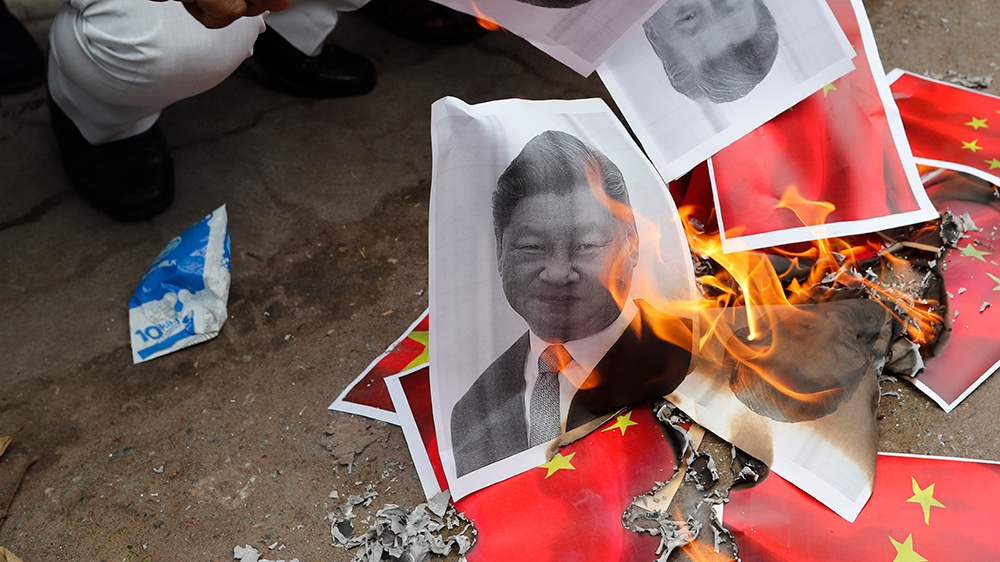 Indians burn photographs of Chinese President Xi Jinping during a protest against the Chinese government in Lucknow , India , Wednesday, June 17, 2020. As some commentators clamored for revenge, India