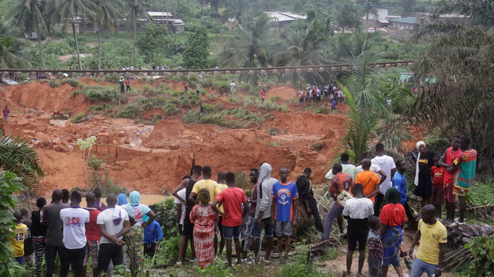 People watch an area affected by landslide after unusually heavy rains that killed at least 13 people overnight in Anyama near Abidjan, Ivory Coast June 18, 2020/ REUTERS/ Thierry Gouegnon