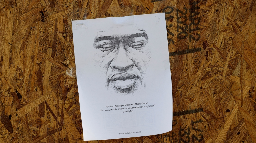 A picture of George Floyd is posted on a boarded-up window, following national protests against his death in Minneapolis police custody, near the White House in Washington, D.C., U.S., June 1, 2020. R