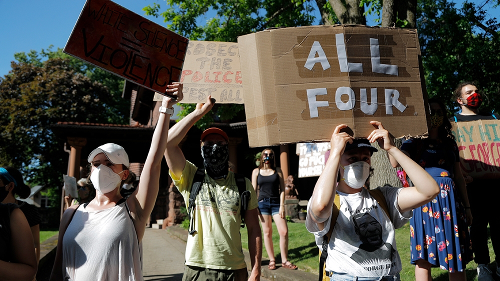 Demonstrators gather at the Minnesota governor's mansion Monday, June 1, 2020, in St. Paul, Minn. Protests continued following the death of George Floyd, who died after being restrained by Minneapolis