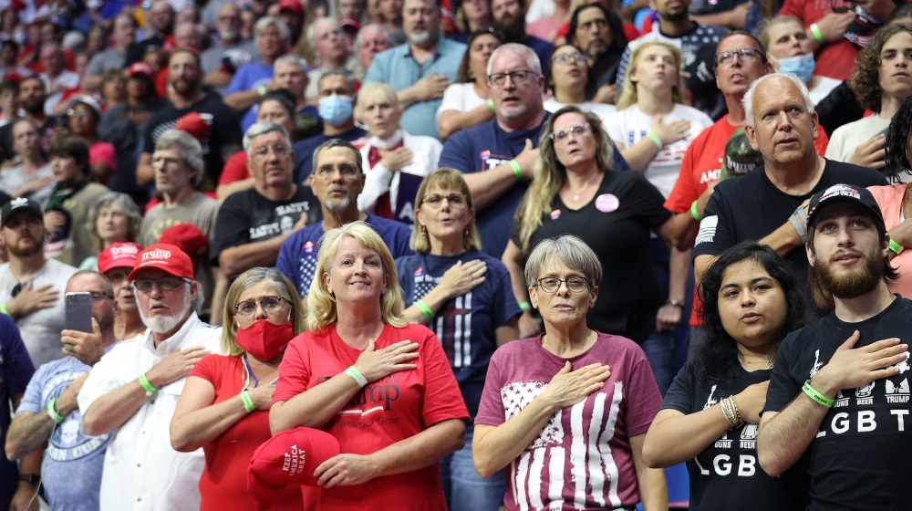 Supporters participate in the Pledge of Allegiance during a campaign rally for U.S. President Donald Trump at the BOK Center, June 20, 2020 in Tulsa, Oklahoma. Trump is holding his first political ral