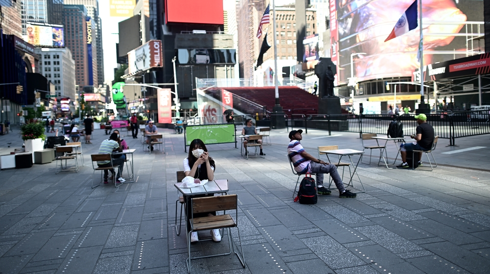 People sit on tables , respecting social distancing at Times Square as New York City enters phase two of reopening June 22, 2020. New York City begins phase two reopening on June 22, 2020 as people ca