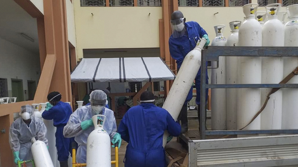 Kenyan nurses wear protective gear during a demonstration of preparations for any potential coronavirus cases at the Mbagathi Hospital, isolation centre for the disease, in Nairobi