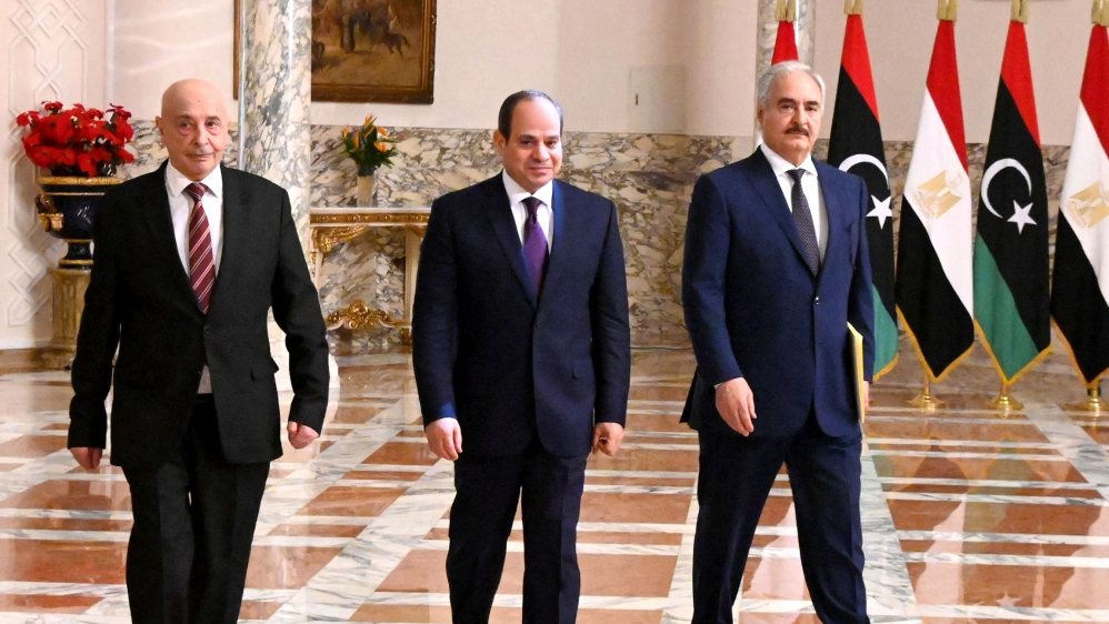 A handout picture released by the Egyptian Presidency on June 6, 2020 shows Egyptian President Abdel Fattah al-Sisi (C), Libyan commander Khalifa Haftar (R) and the Libyan Parliament speaker Aguila Sa