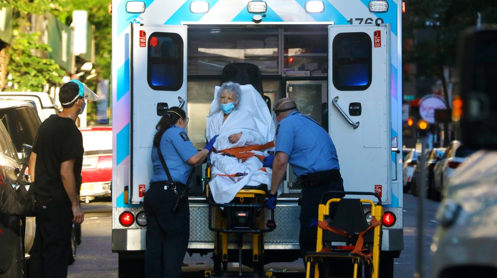 InfoSnipz A elderly woman is transported into an ambulance on Manhattan's west side in New York, New York, USA, 22 June 2020. New York State Governor Cuomo continued to urge caution, particularly as many as 19