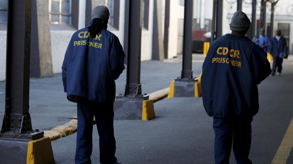 Inmates walk in San Quentin State Prison in San Quentin, California