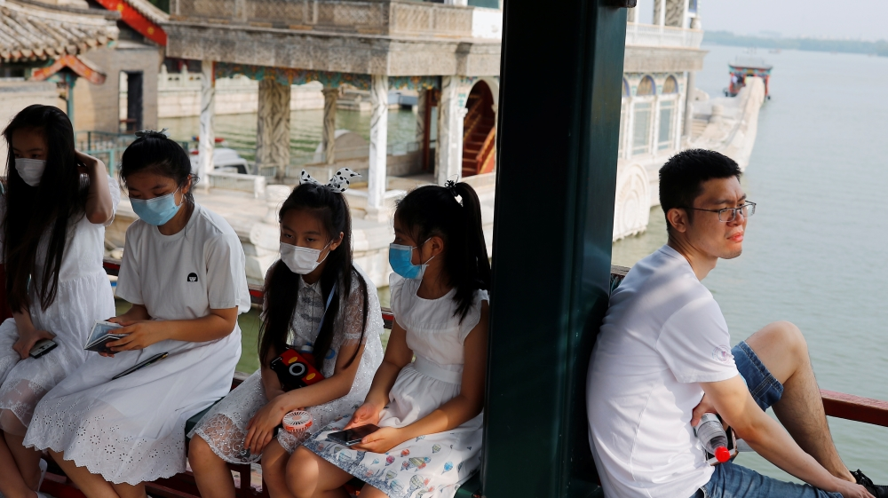 People relax in the park at Summer Palace on a public holiday, after a new outbreak of the coronavirus disease (COVID-19), in Beijing