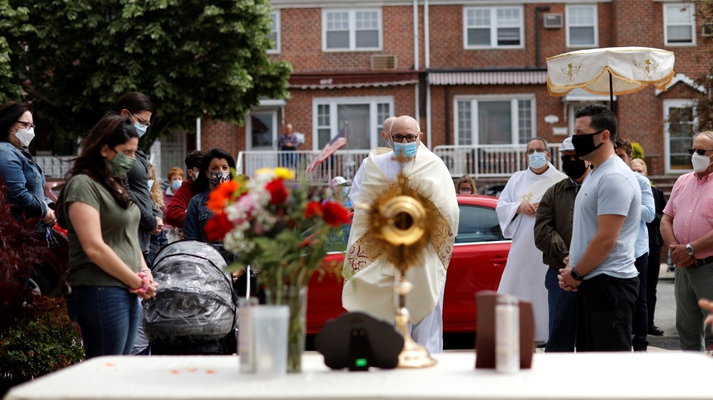 Priests lead Blessed Sacrement procession through Queens neighborhood during outbreak of the coronavirus disease (COVID-19) in New York