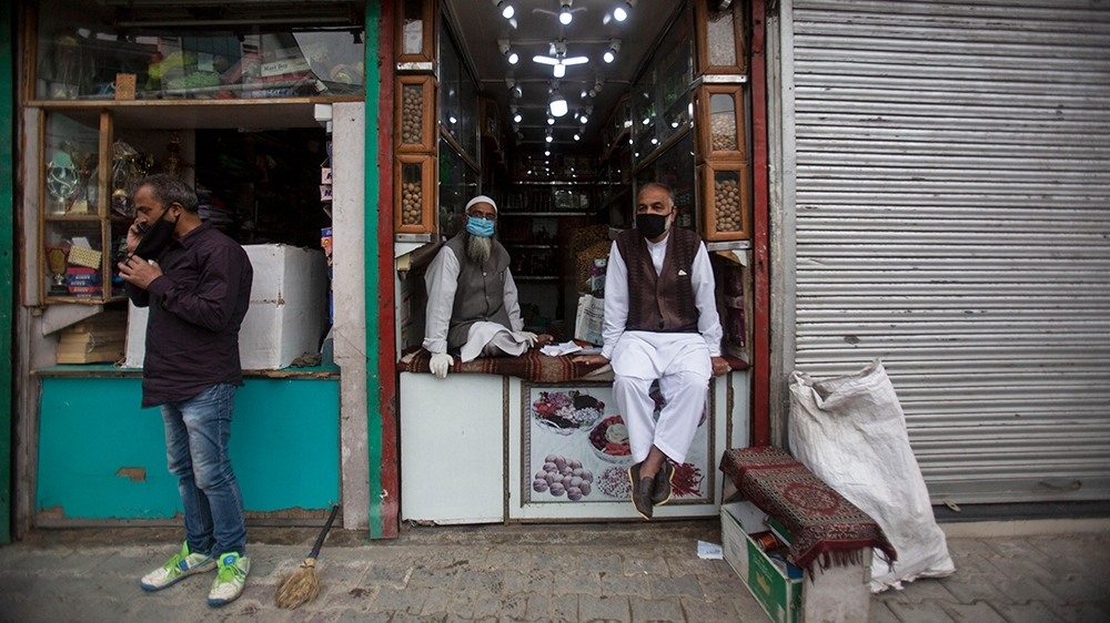 Kashmiri shopkeepers wearing face-masks wait for customer at a market in Srinagar, India, Saturday, June.13, 2020. Over two-and-a-half months after the coronavirus lockdown or Covid-19, was implemente