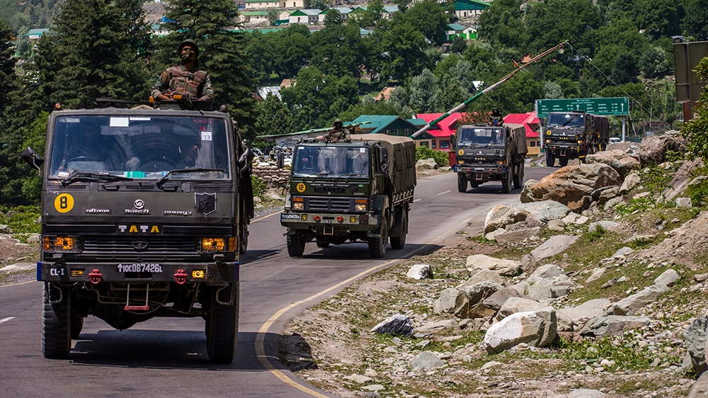 An Indian army convoy drives towards Leh, on a highway bordering China, on June 19, 2020 in Gagangir, India. As many as 20 Indian soldiers were killed in a