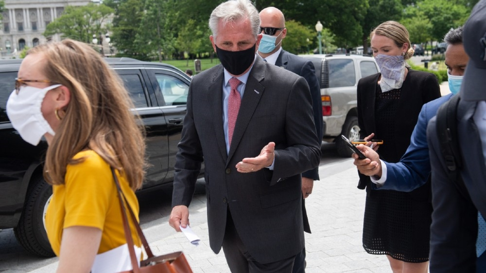 US House Minority Leader Kevin McCarthy, Republican of California, wears a mask as he leaves following a press conference about Republican efforts against House
