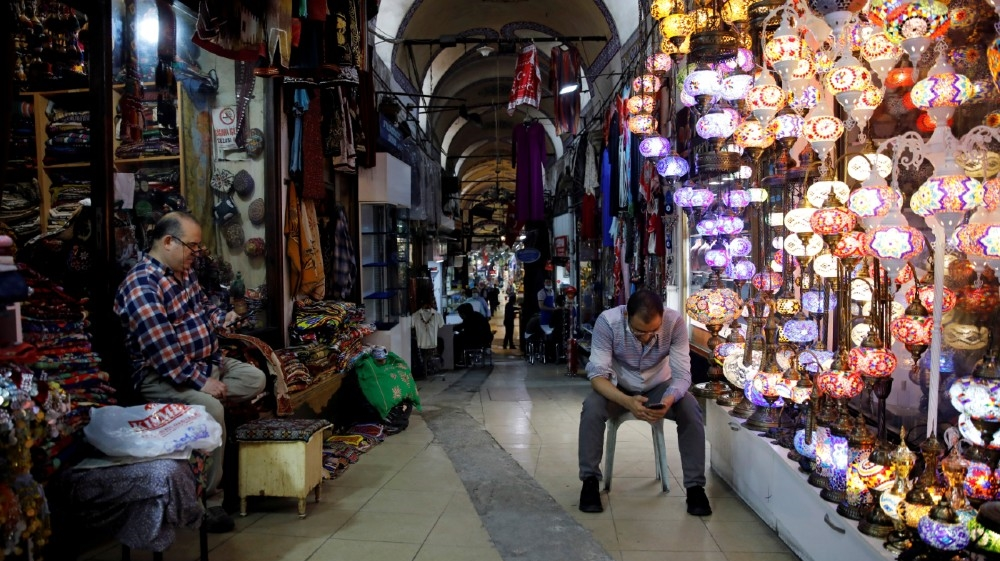 FILE PHOTO: Merchants are seen at Grand Bazaar as it reopens after weeks of the close doors amid the spread of the coronavirus disease (COVID-19), in Istanbul, Turkey, June 1, 2020