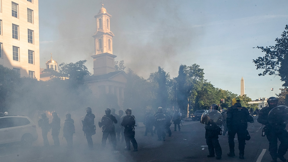 Watchdog to investigate clearing of protesters for Trump photo thumbnail