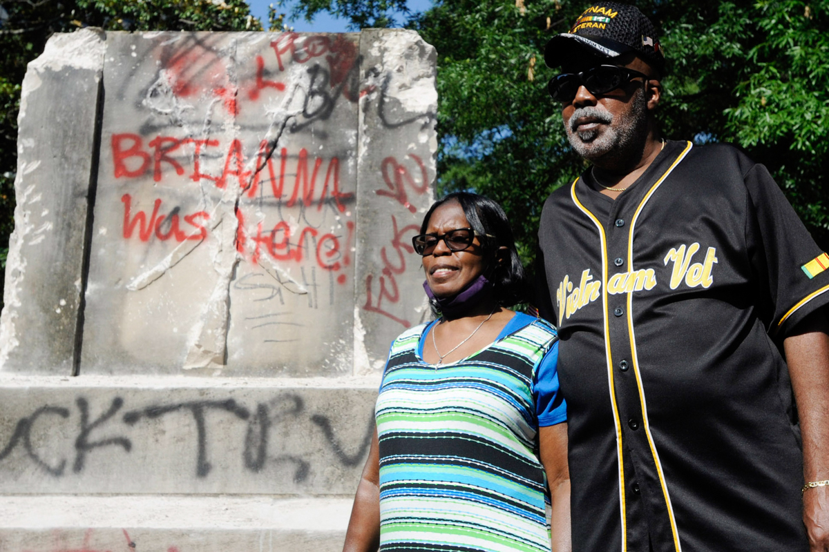 Sarah Collins Rudolph, who survived a racist church bombing that killed sister Addie Mae Collins and three other girls in 1963, stands with husband George Rudolph at the remains of a Confederate memorial that was removed in Birmingham, Alabama. [Jay Reeves/AP Photo]