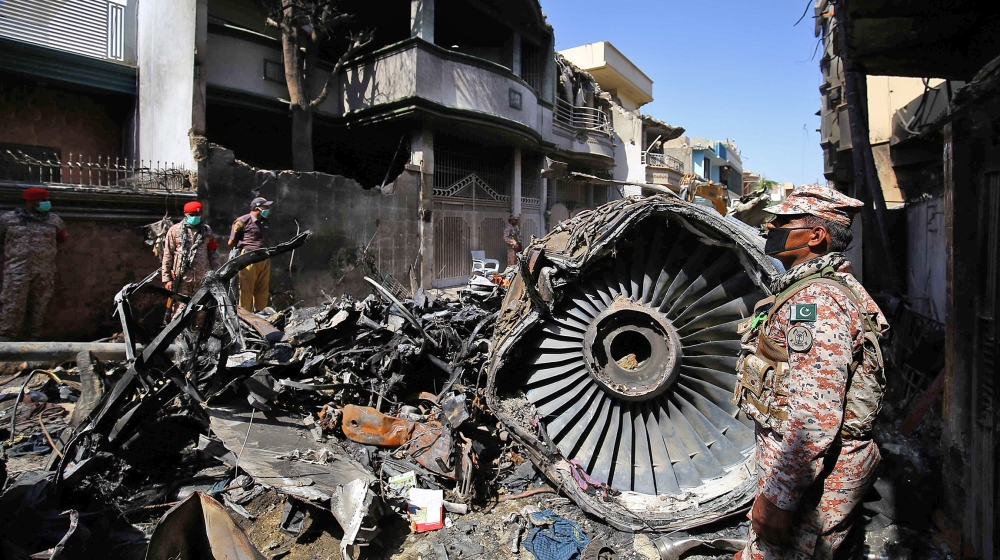 The wreckage of the passenger plane of state-run Pakistan International Airlines, at the crash scene in a residential area, in Karachi, Pakistan, 22 May 2020 after a Pakistan International Airlines pa