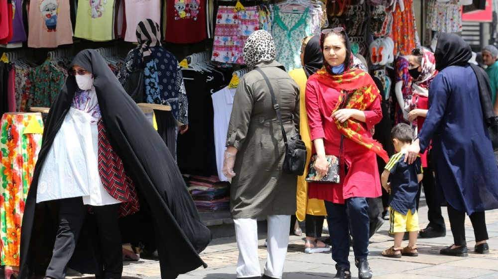 Iranians shop the capital Tehran on June 2, 2020 during the COVID-19 coronavirus pandemic. Iran today lamented that people were ignoring social distancing rules as it reported more