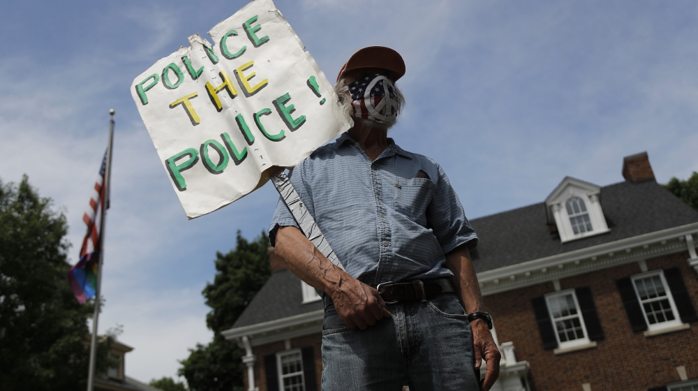 People gather in front of the St. Paul, Minn. governor's mansion on Saturday, June 6, 2020. Protests continue over the death of George Floyd who died after being restrained by Minneapolis police offic