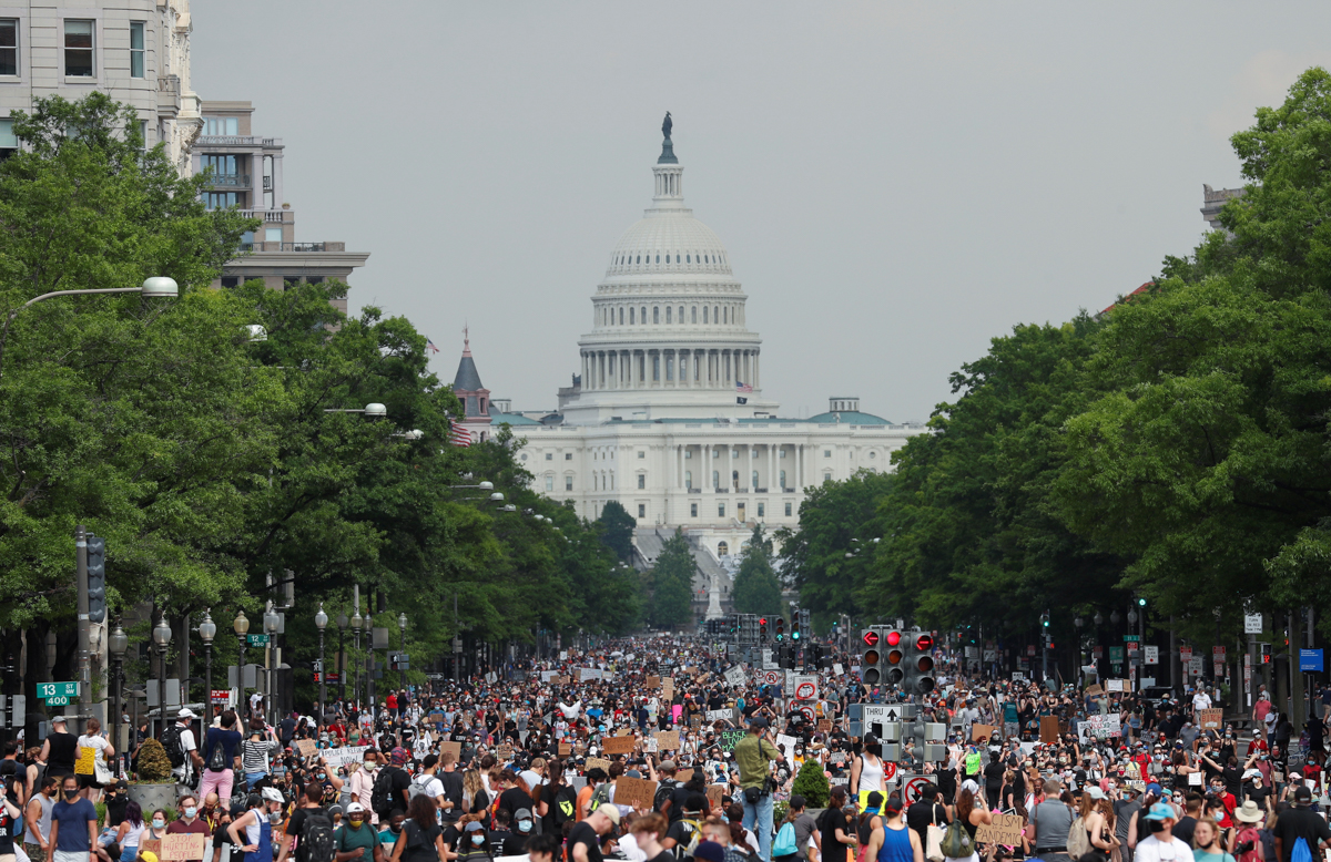 Demonstrators march from the U.S. Capitol Building during a protest against racial inequality in the aftermath of the death in Minneapolis police custody of George Floyd, in Washington, U.S., June 6,
