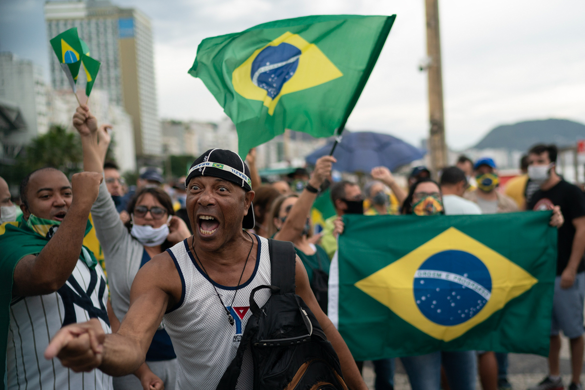 A demonstrator shouts slogans during a protest in support of Brazil's President Jair Bolsonaro at Copacabana beach in Rio de Janeiro, Brazil, Sunday, June 7, 2020. (AP Photo/Leo Correa)