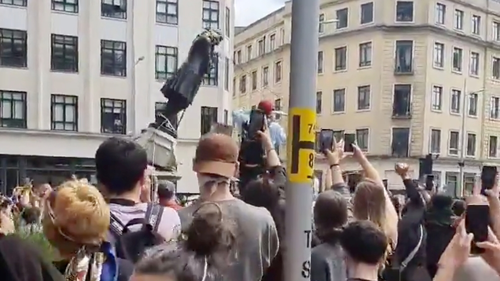 Protesters tear down a statue of Edward Colston during a protest against racial inequality in Bristol, Britain June 7, 2020 in this screen grab obtained from a social media video. Mohiudin Malik/via R