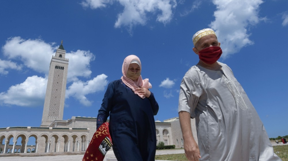 Tunisians wearing protective masks leave after attending the first Friday prayer following a 3-months suspension due to the novel coronavirus, at the Malek Ibn Anas Mosque in Carthage