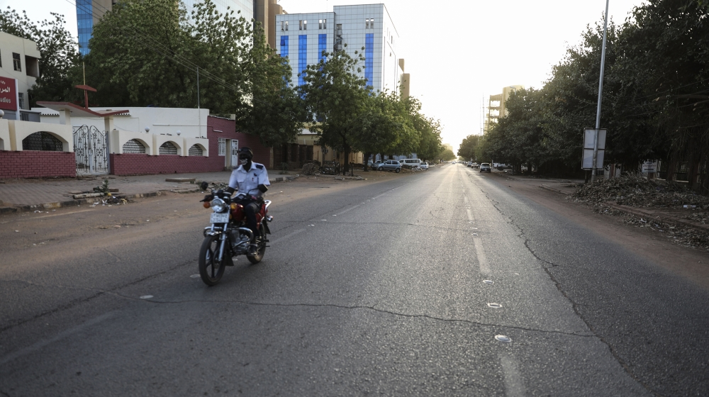 An empty avenue is seen in Khartoum , Sudan, Tuesday, March 24, 2020 as Sudanese government ordered a nighttime curfew to prevent the spread of the coronavirus. (AP Photo/Marwan Ali)