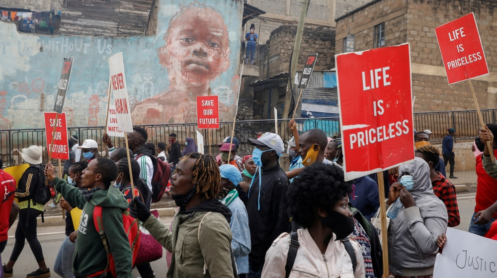 Protesters hold placards during a demonstration against police killings and brutality, in the Mathare slum in Nairobi, Kenya, June 8, 2020. REUTERS/Baz Ratner TPX IMAGES OF THE DAY