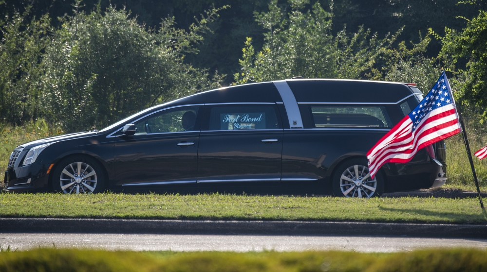 The hearse carrying the coffin arrives at the church for the funeral for George Floyd on June 9, 2020, at The Fountain of Praise church in Houston, Texas. Floyd died after being restrained by Minneapo