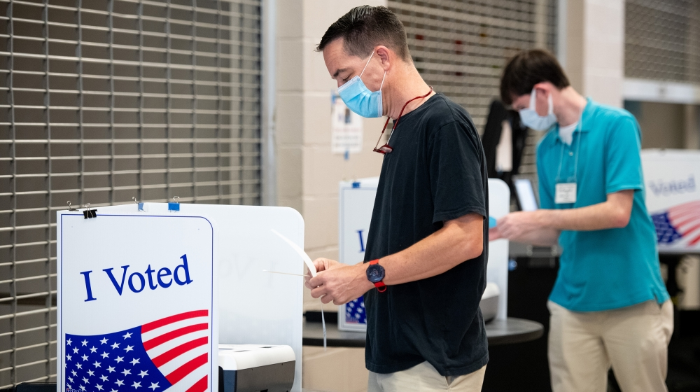 John Sherer looks at his printed ballot at Dreher High School on June 9, 2020 in Columbia, South Carolina. Georgia, Nevada, North Dakota, South Carolina and West Virginia hold primaries today. (Photo